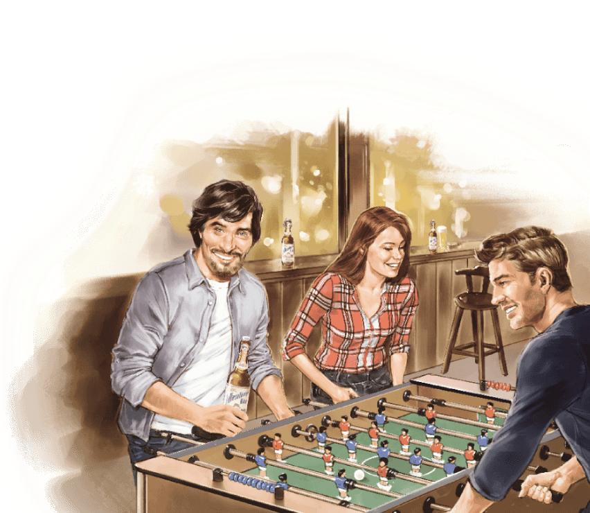 Junge Menschen spielen Tischfußball und trinken Wieselburger Bier